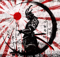 Graffiti on a brick wall of a Japanese warrior in an ink circle with a red sun