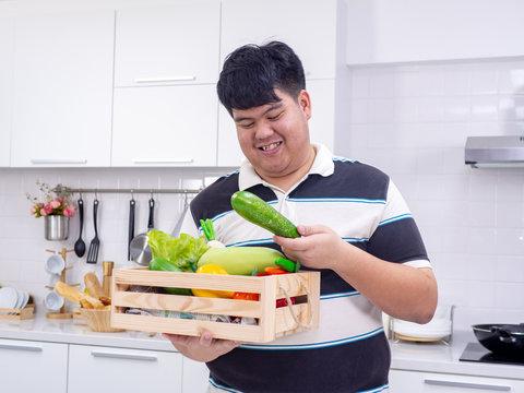 Fat man choose healthy food from basket