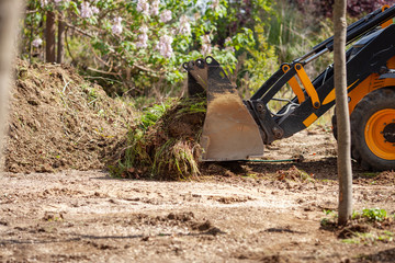 bulldozer cleaning up