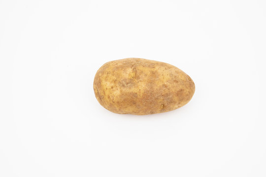 A raw russet potato isolated on white background