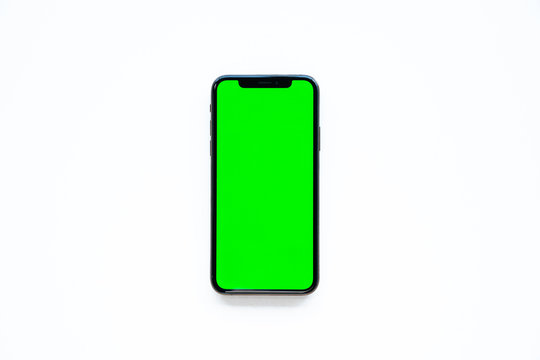 iPhone XS, smartphone, green screen on white background