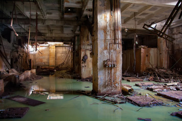 Flooded collapsed basement of abandoned industrial building