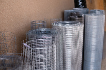 The chain-link, a grid for building in a roll costs in a warehouse