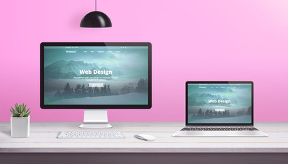 Wall Mural - Theme design studio concept with computer display and laptop with flat design web site.