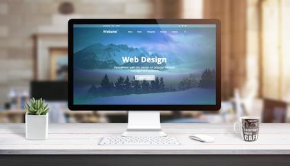 Wall Mural - Modern web design page on computer display. Concept of web design studio work desk.