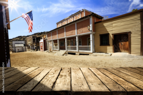 Wooden old table background and American city background