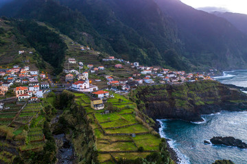 Wall Mural - Beautiful mountain village on Madeira island, Portugal, at sunset. Aerial view.