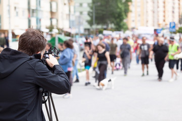 Camera operator filming protesters during street protest