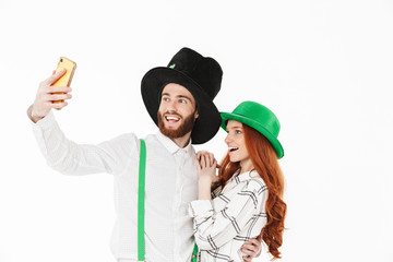 Happy young couple wearing costumes, celebrating