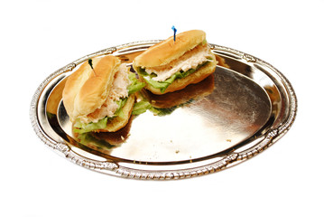 Two Tuna Sandwiches Leftover on a Silver Platter