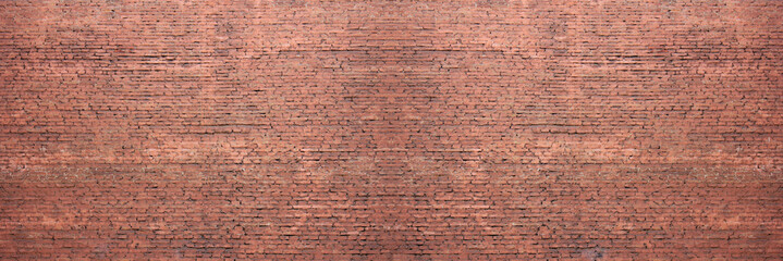 Red old brickwall stone pattern on weathered house wall. Rustic retro brick wall structure, long...