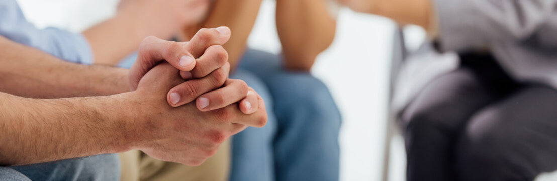 panoramic shot of hands of man during group therapy session with copy space