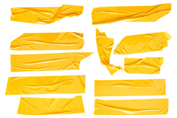 Set of yellow tapes on white background. Torn horizontal and different size yellow sticky tape, adhesive pieces. Wall mural