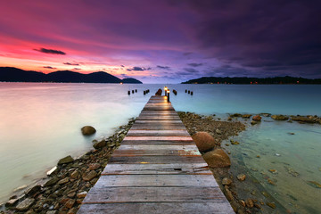 Wall Mural - Sunset over the wooden jetty in marina island, perak