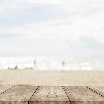 empty wood table on blurred of sea beach