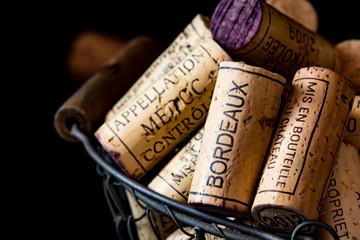 Spoed Foto op Canvas Wijn old cork stoppers of French wines in a wire basket