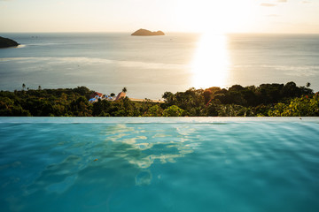 sunset pool overlooking the sea and mountains