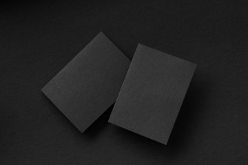 Blank portrait A4. brochure magazine isolated on gray, changeable background / black paper isolated on Black, dark tone