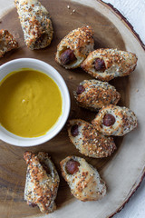 mini hot dogs with sesame seed pastry dough wrap appetizer with mustard
