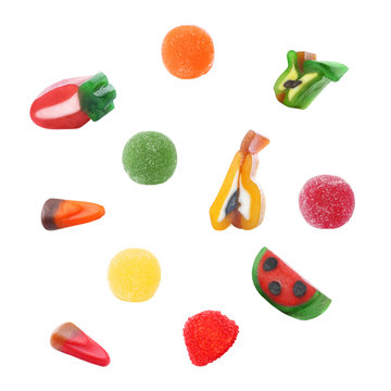 Set of different colorful candies on white background