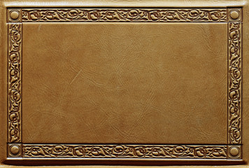 Leather texture close up with the deep embossed frame around the edges