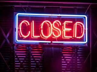 Closed neon sign on the door in Brazil