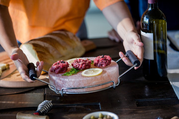 Midsection of woman serving food on wooden table