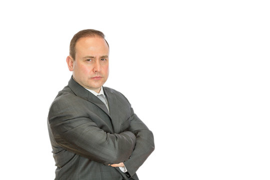Stern businessman with crossed arms and copy space