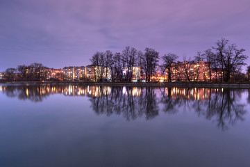 View on Ivano-Frankivsk city from the lake at night with long exposure