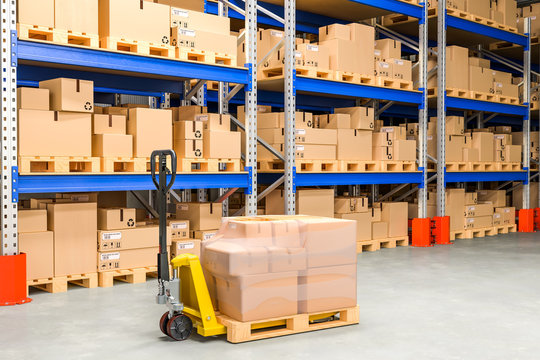 Pallet jack with cardboard boxes in storehouse, 3D rendering