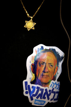 A supporter of Benny Gantz, leader of Blue and White party, wears a sticker on his shirt during an election campaign event in Ashkelon, Israel