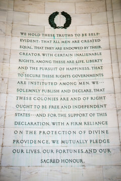 Pursuit of happiness inscription excerpted from the Declaration of Independence carved in white marble on the curved rotunda wall of the Thomas Jefferson Memorial in Washington DC, USA