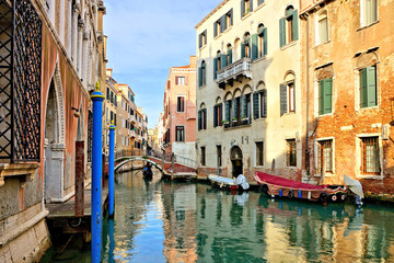 Fototapete - Romantic canals with reflections, bridge and gondola, Venice, Italy
