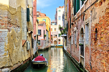 Wall Mural - Narrow canal with boat in the beautiful city of Venice, Italy