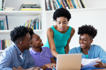 African american female teacher with students