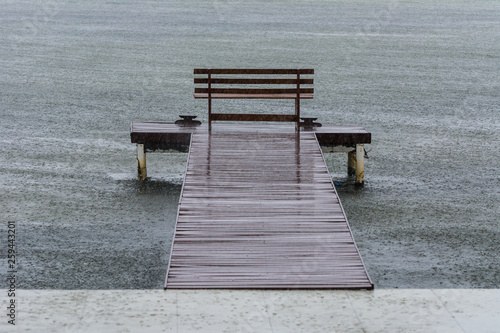 Wooden bench on a pier in front of the Conceicao Lagoon