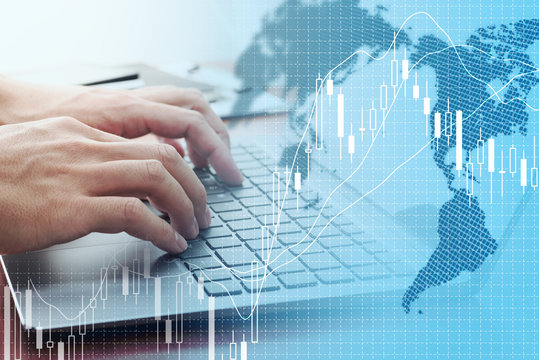 Global stock market concept. Using laptop for stock exchange.World map, candlestick chart and laptop.