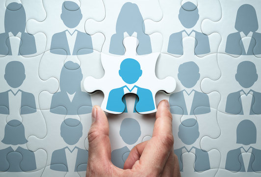 Selecting person and building team. Business people relationship concept.Connecting last jigsaw puzzle piece.