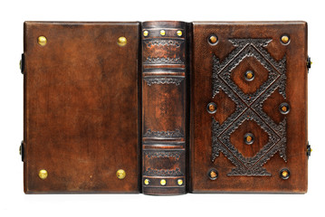 Medieval styled book cover with the deep embossed motifs and brass pins on the front cover, full leather bound captured isolated in high resolution