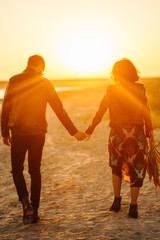 Printed kitchen splashbacks Artist KB Enjoying time together. Stylish and loving couple enjoying each other by the sea. The couple is young and in love. The concept of youth, love and lifestyle. Beautiful sunset on a summer day.
