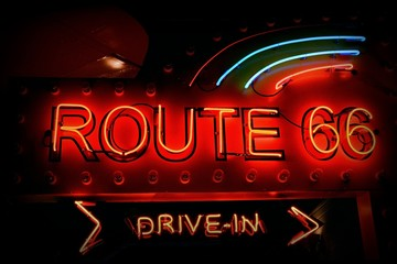 Foto op Plexiglas Route 66 Old neon red sign of Route 66.