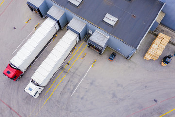 Aerial Shot of Industrial Warehouse/ Storage Building/ Loading Wall mural