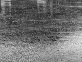 rain drop on wet asphalt road black and white style