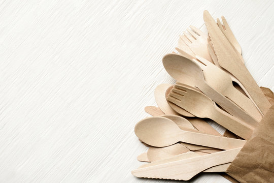 Disposable tableware from natural materials, wooden spoon, fork, knife, eco-friendly. Place for text