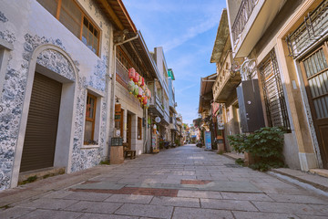 Tainan, Taiwan - December 4, 2018: People walked along the Shennong street, A landmark avenue dating from the Qing Dynasty, lined with quaint, historic shops and homes in Tainan, Taiwan.