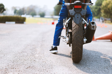 back image of a street bike racer with with soft-focus and over light in the background