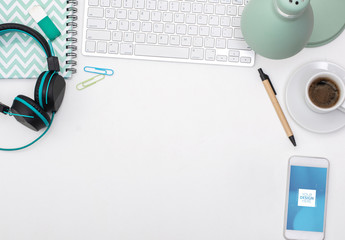 White Desk with Smartphone and Office Supplies Mockup
