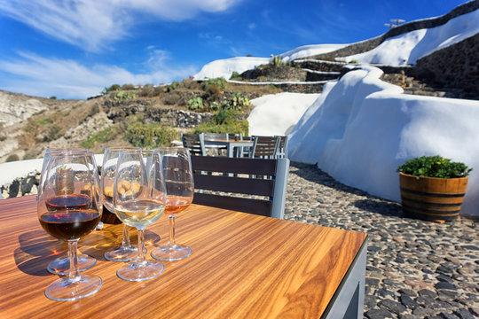 Glasses of wine in a terrace, Santorini, Greece.