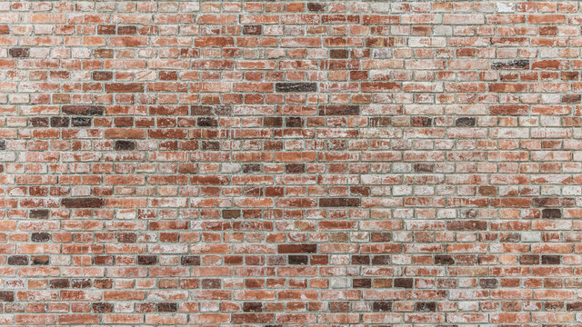 Brick wall of red color, old red brick wall texture background.