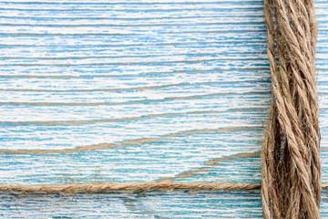 Jute twine on blue wooden background